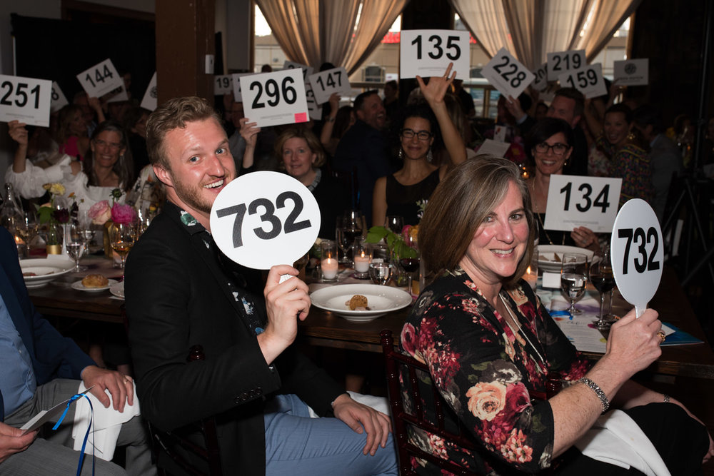 fred hutch fundraiser auction paddles raised