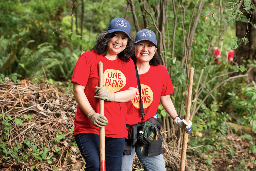 seattle love parks foundation volunteers working in forest