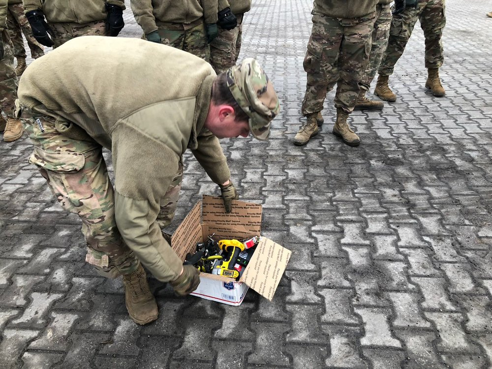 US Soldiers in Poland receiving tools