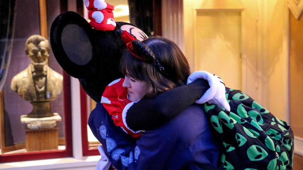 Getting hugs from the sweetest mouse in the world.