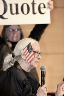 Sign-holder (Lynne Jackson) and the Judge (Jeanne Finley)