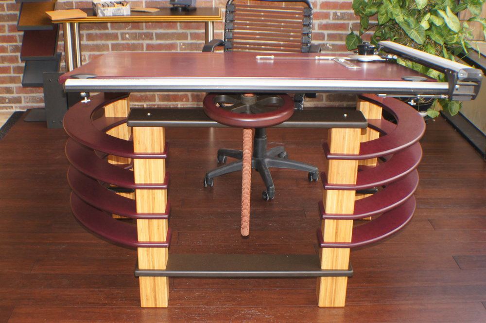 Dimensional Bamboo Lumber stands out against the darker plane of the top and arcs of the sides of this custom drafting table.  Built for a living/designing space…..It just doesn't need to be subtle.