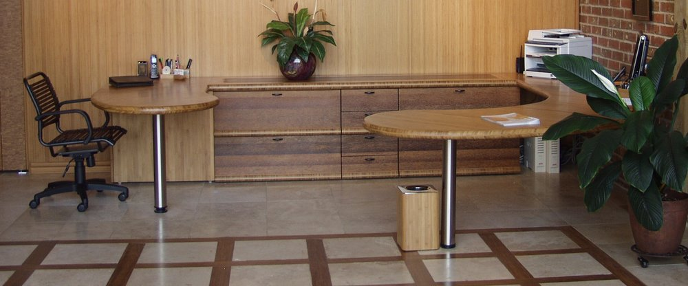 """A work space should never be this clean…It was new. The tops are a double layer of 1"""" bamboo 3-ply; the credenza front is coco palm flat grain; the insert at right is edge grain coco palm."""