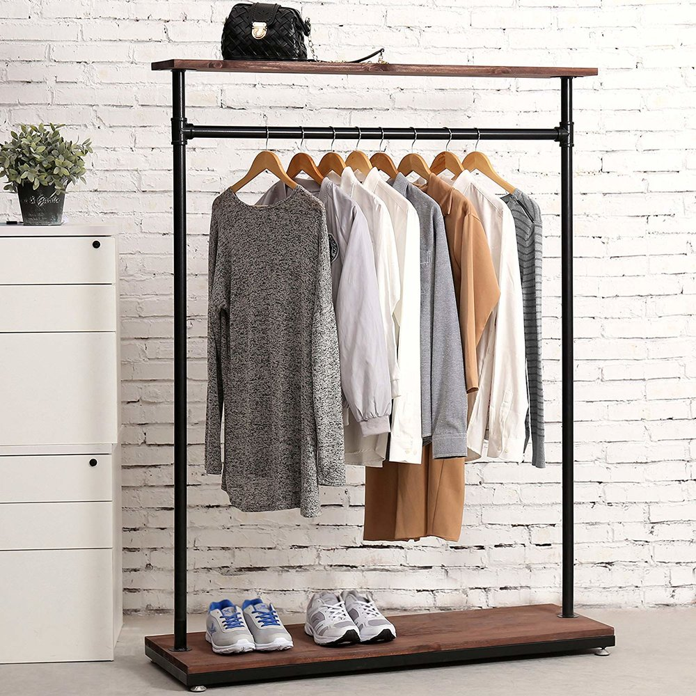 $99 - Industrial Wood & Pipe Garment Rack | Ben and I each have one of these and I can't imagine going back to hidden closets or messy dressers.