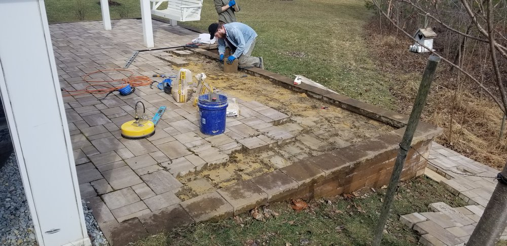 During - Pressure washing and re-leveling