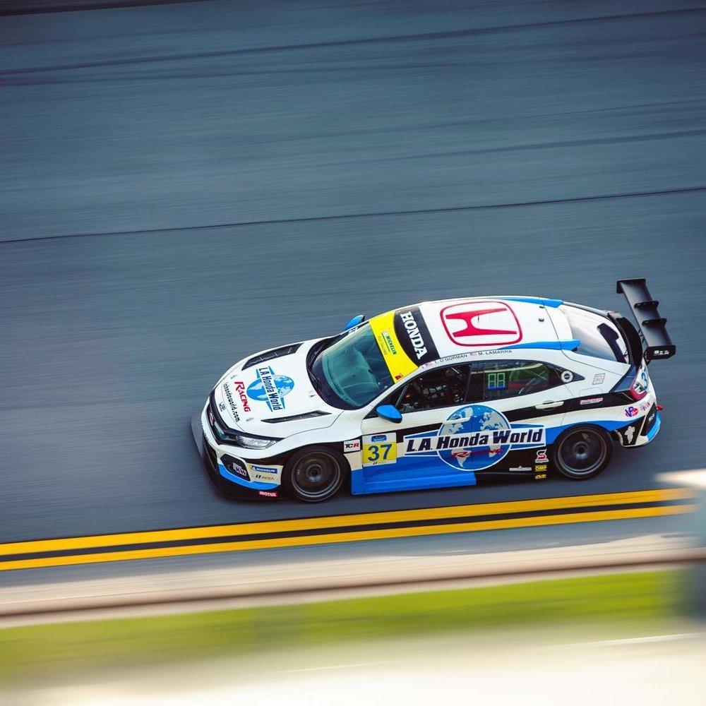 Daytona International Speedway, Daytona, FL. Tom O'Gorman hits the banking in Daytona in preparation for the BMW Endurance Challenge on January 25th, the first race of the Michelin Pilot Challenge.