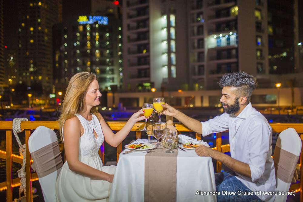A-couple-having-dinner-onboard-alexandra-dhow-cruise-dubai-marina.jpg