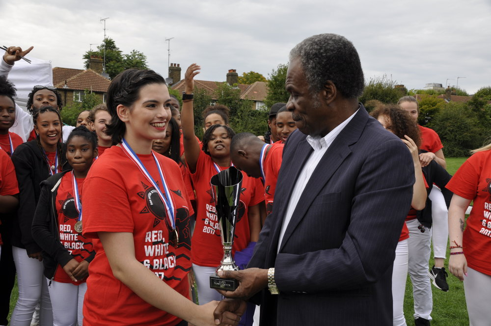 Aoife receiving Pan Nation Junior Panorama  trophy from TT High Commissioner, Mr London.