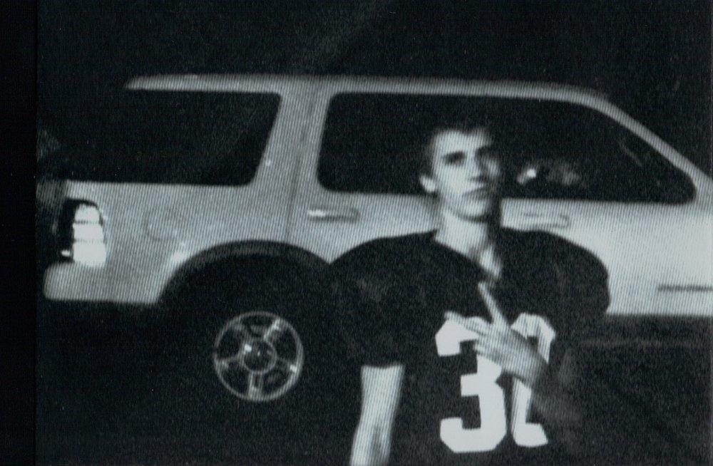 connor football uniform with car.jpg