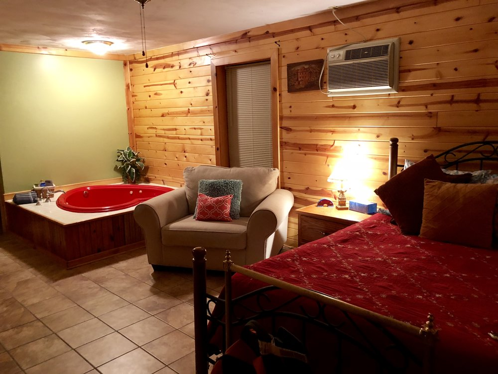 The inside of our cozy cabin. It also had a small full kitchen and the owner stocked it with a bag of ice and a container of coffee. Yes, that is a giant heart shaped tub…