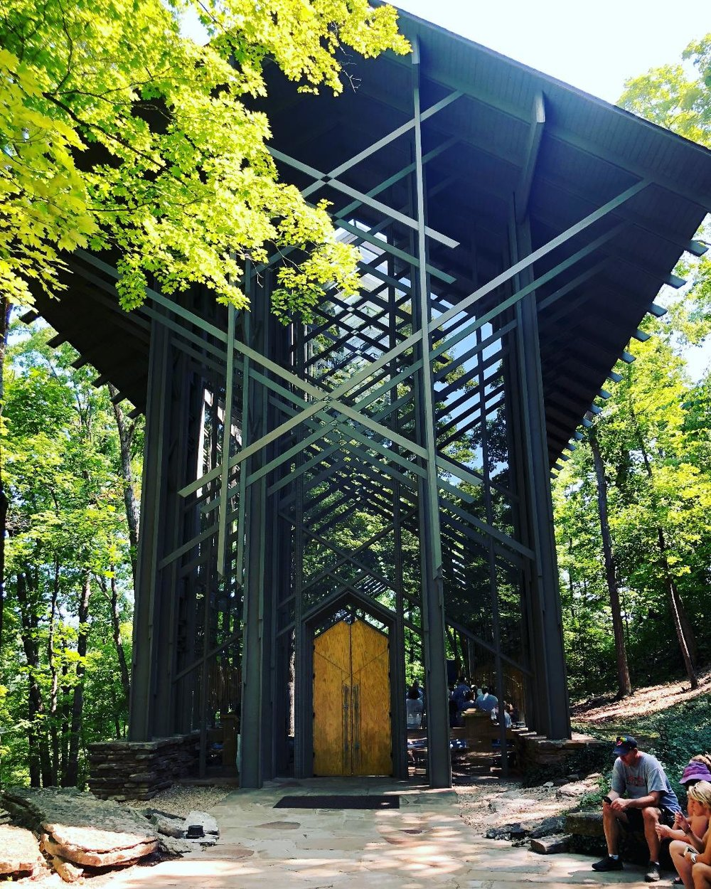 Thowncrown Chapel   We stopped at the Thorncrown Chapel on a Sunday and there was Sunday church services in progress. The 48-foot tall glass church is breathtaking and I couldn't imagine attending church services in such a majestic place.