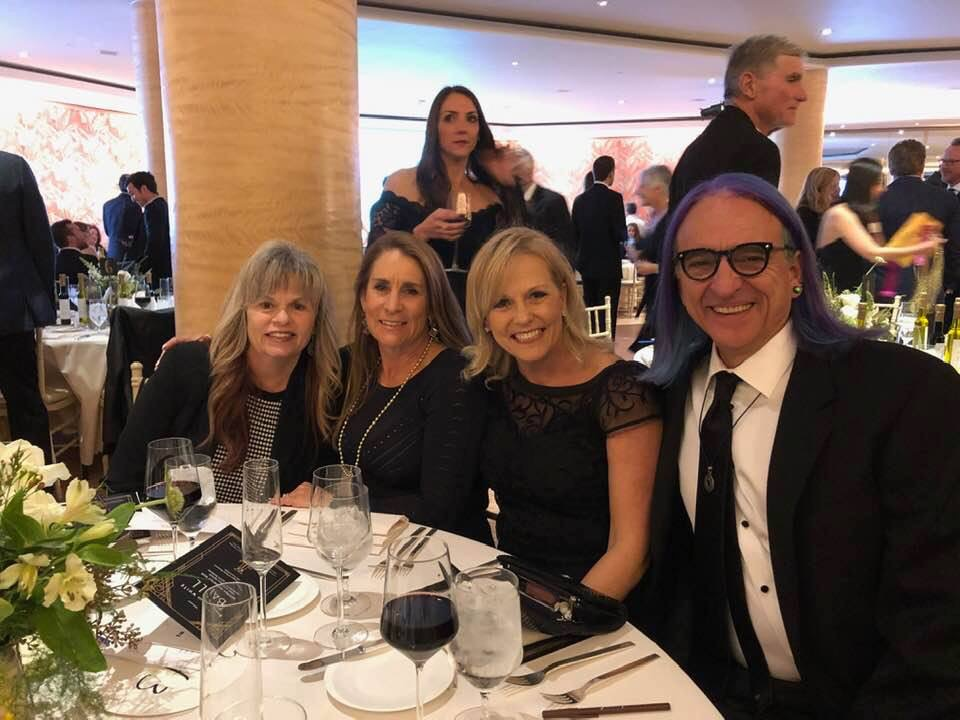 "Kris Rice Giles, Kelly Kennedy, Lorie Vos, Micheal Francis Smith; JLSB Spring Gala March 9th, 2019  Kris Rice Giles writes…  ""What a great night at the JLSB Gala with my sister Lorie Vos as well as the most amazing staff Kelly Kennedy and Micheal Frances Smith as we were recognized for the work 4 Kids 2 Kids is doing to end human trafficking…such an honor!"""