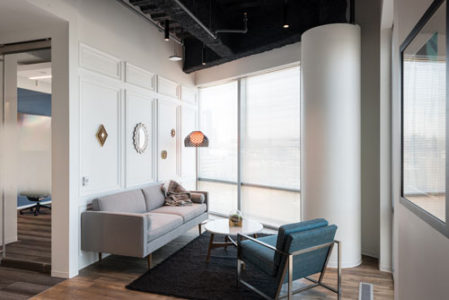 Facility space at the Capital One office is maximized by tucking soft seating into an open corner for a cozy spot in which to relax or socialize. (Photos: Adam Auel Photography, courtesy of Capital One)