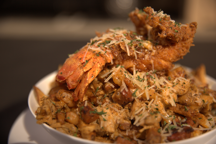 Jambalaya Fries topped with Fried Lobster Tail from the Billionaire Burger Boyz food truck in South Central Los Angeles.jpeg