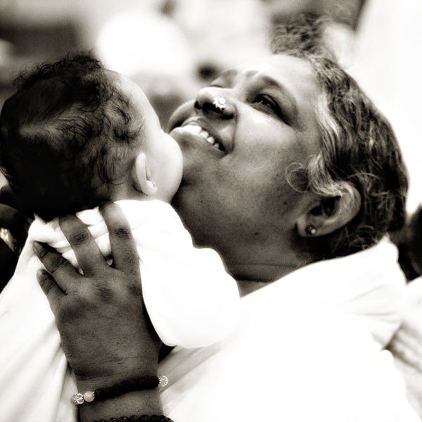 Mata Amritanandamayi, Amma in an Embrace.