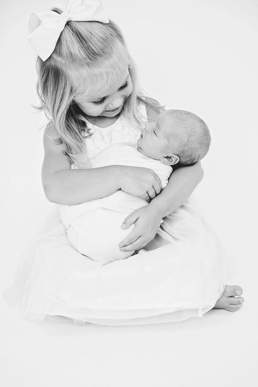 newborn-sibling-smile.jpg