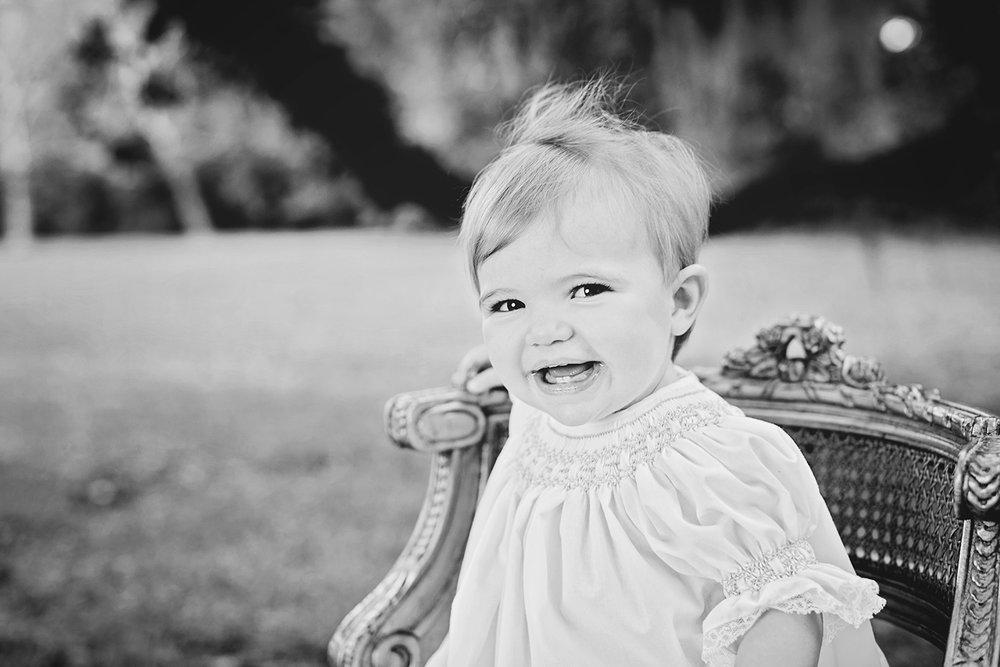 baby-girl-smiling-black-white.jpg
