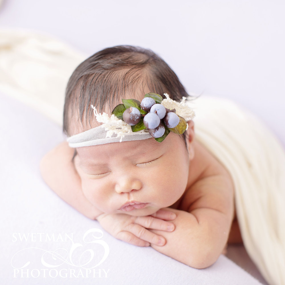 newborn-photographer-ocean-springs-mississippi-girl-headband-blueberries.jpg