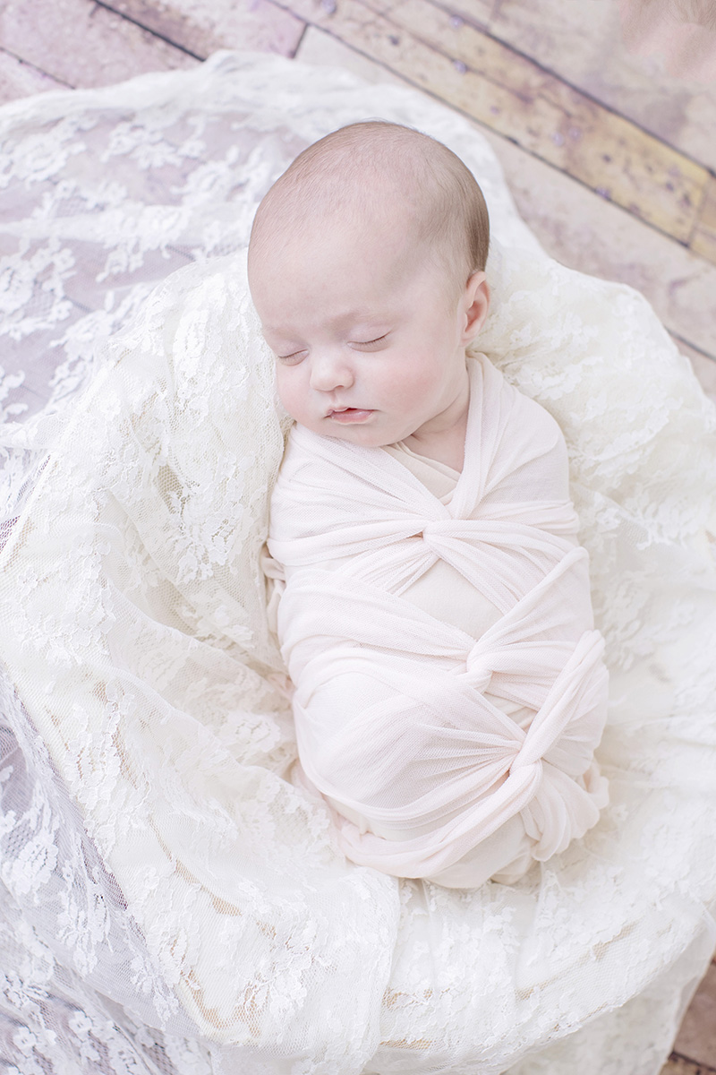 ocean-springs-newborn-photographer-lace-blanket-swaddle-baby.jpg