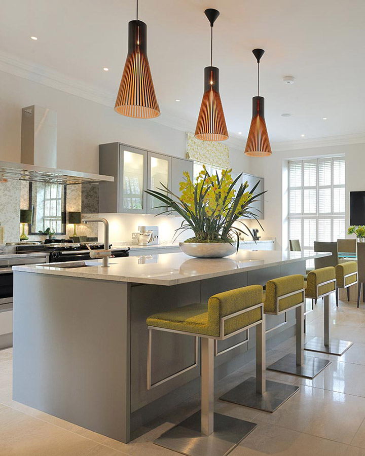 - With views over the All England Lawn Tennis club, Clare wanted an elegant, relaxed but also practical feel for this family home. The contrasting copper shades and citrus bursts make for a vibrant kitchen, the ideal focal point for a busy family home. Characterful wallpapers and contrasting textures bring the spaces to life, with deeper warming colours in the bedrooms and chic grey tones running throughout.