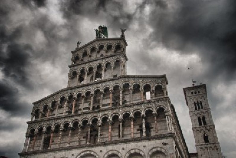 8156825-church-facade-in-lucca-with-bad-weather-background-italy.jpg