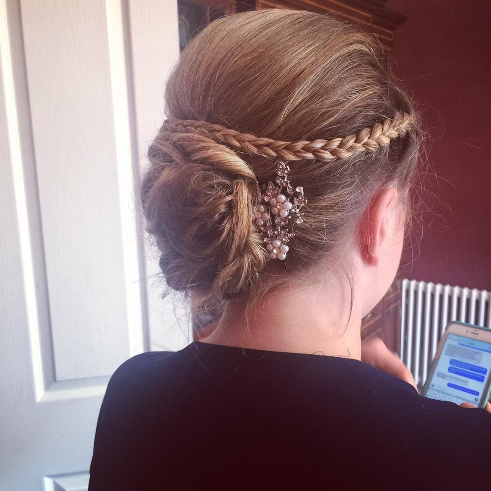 COMBINING TWISTS AND PLAITS WITH YOUR HAIR UP ADDS A BEAUTIFUL ELEGANT FINISH