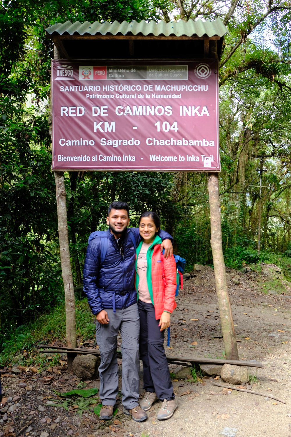 Photo in front of KM 104 signage