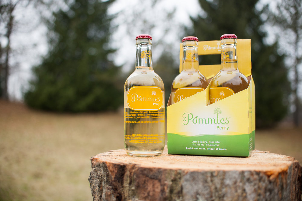Clean bottle design for Pommies' Perry pear cider included logo retouching and package design.