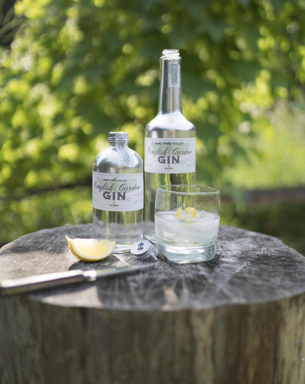 Package and label design for Grand Spirits Distillery English Garden Gin. Includes a small and big size for the Headwaters gin. Serve up with tonic water and a lemon.