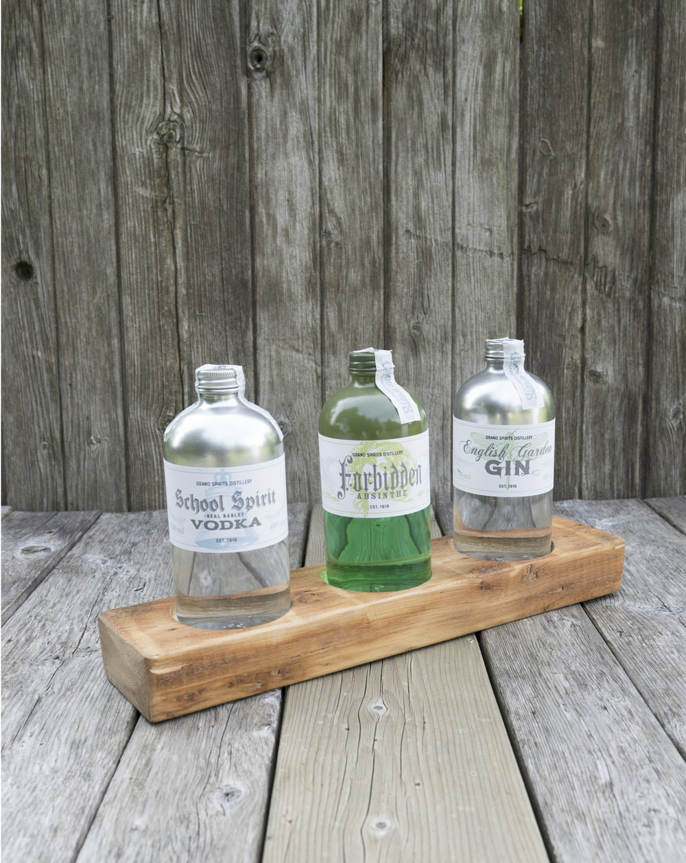 Spirits collection by Grand Valley Distillery including Forbidden Absinthe, English Garden Gin and School Spirit Vodka. Labels designed with vintage aesthetic.