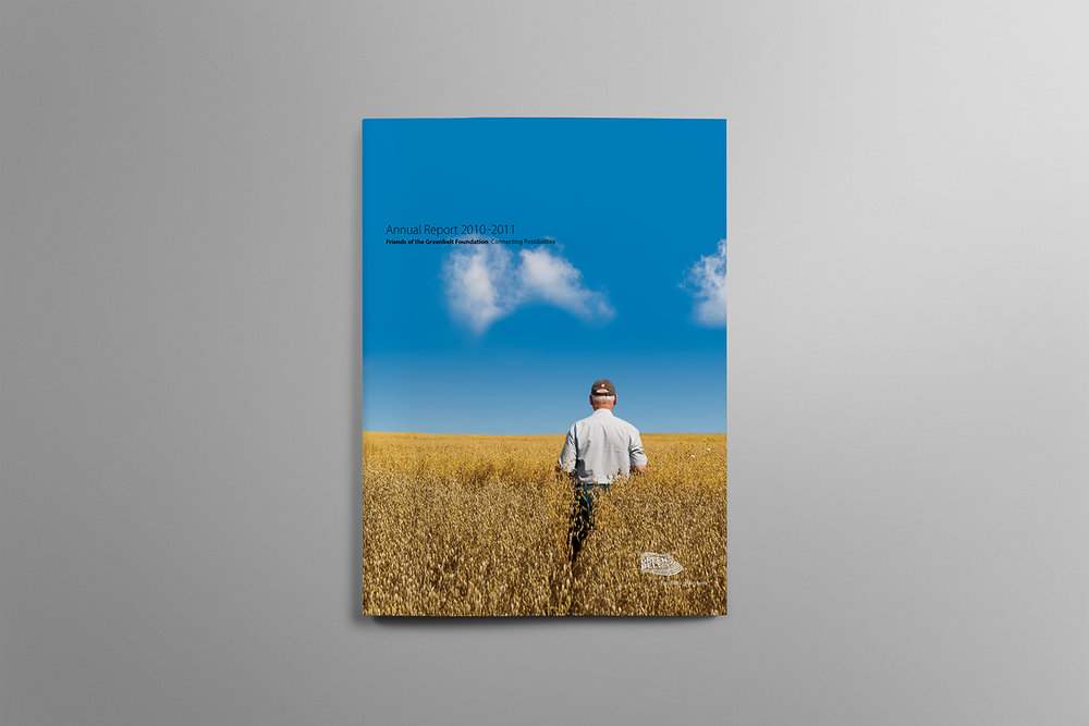 Farmer overlooking his successful crop under a blue sky on the cover on the 2010-2011 Greenbelt Annual Report