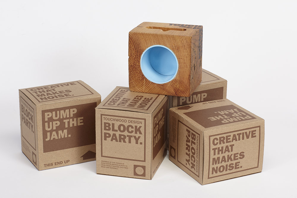 Packaging and the blue barnboard speaker.