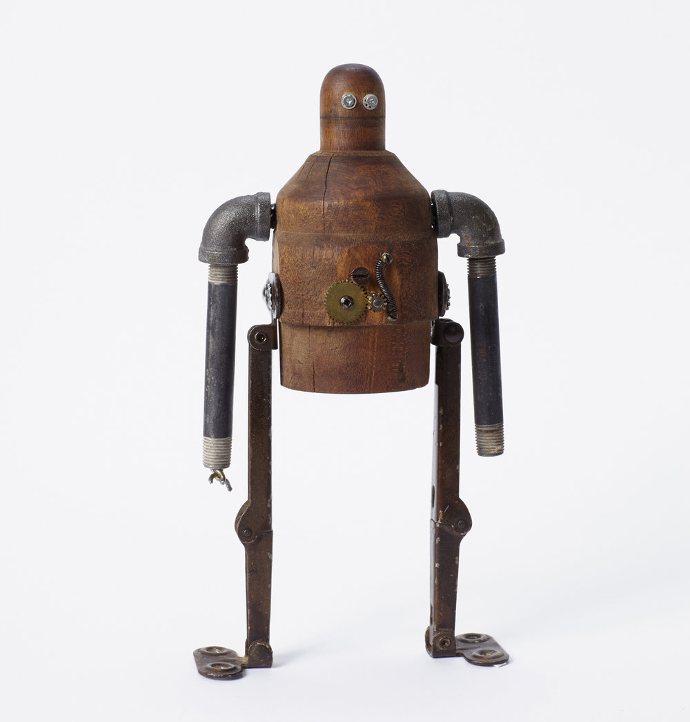 Robot made from steel rods and wood.