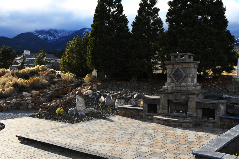 Outdoor fireplace with patio pavers in Reno, NV