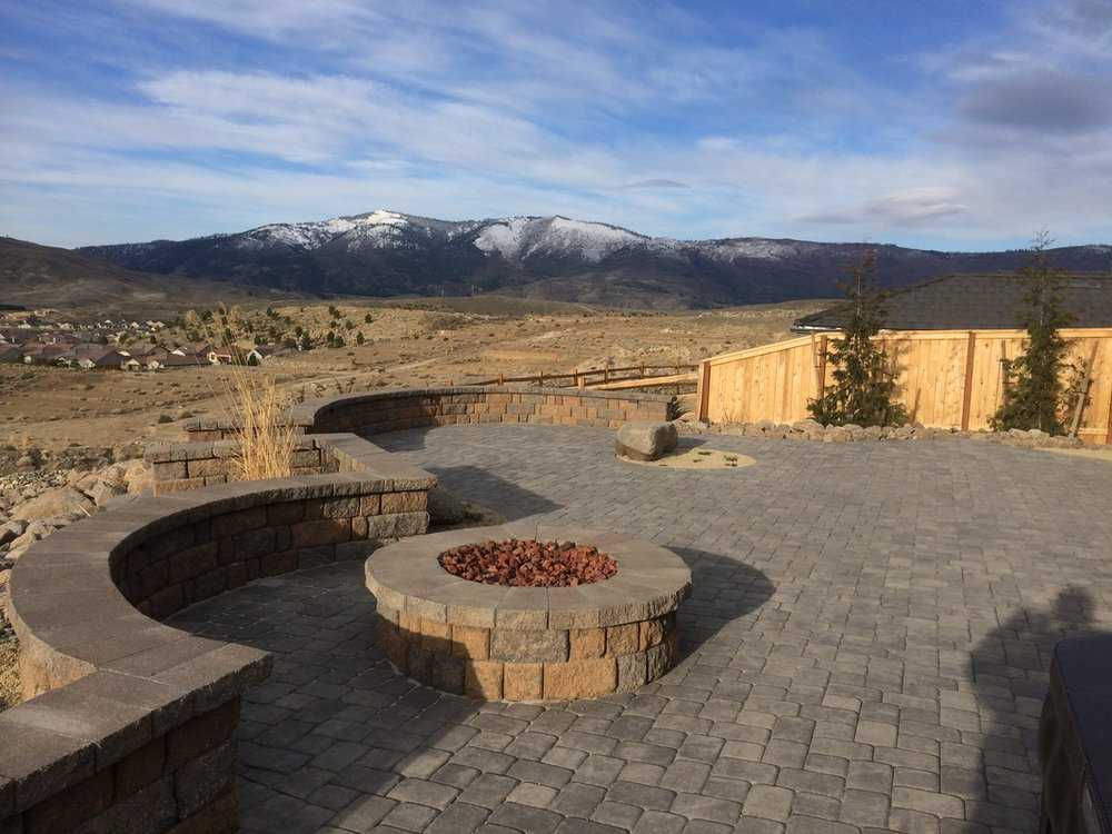 Landscape design with outdoor fireplace in Reno, NV