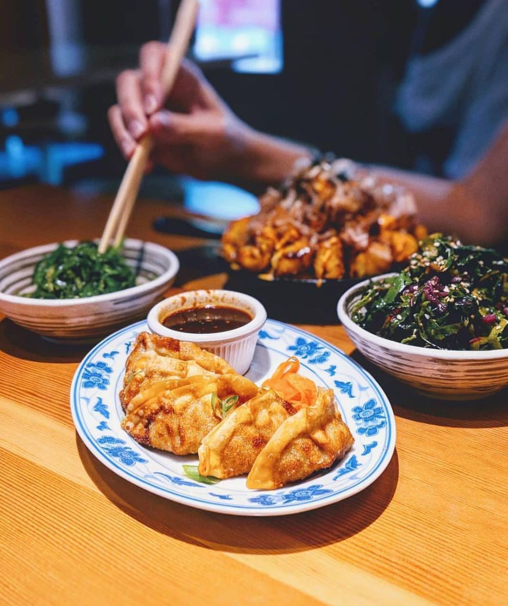 SIDES - wakame salad — $3 light, refreshing vegetarian seaweed salad.smoked pork sliders (2) — $5fermented black bean sauce, slaw, spicy mayo.fried potstickers — $5pork + veggie gyoza, potsticker sauce.greens + sesame — $6swiss chard, pickled cabbage, walnuts, shiitakes.okonomiyaki tots — $7tonkatsu sauce, togarashi, creamy-spicy sauce, bonito.