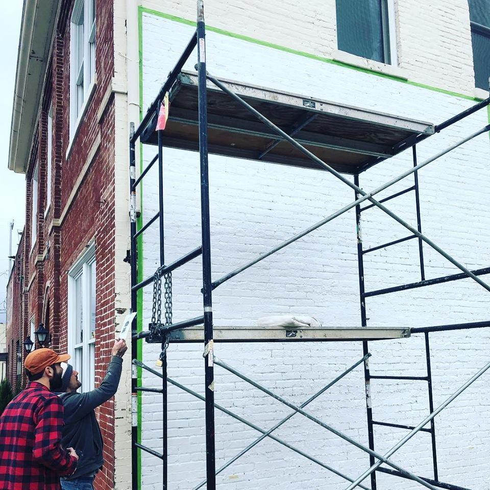 Mural installation along the Eastern wall of The Old City Hall Building, a recipient of a property tax abatement.