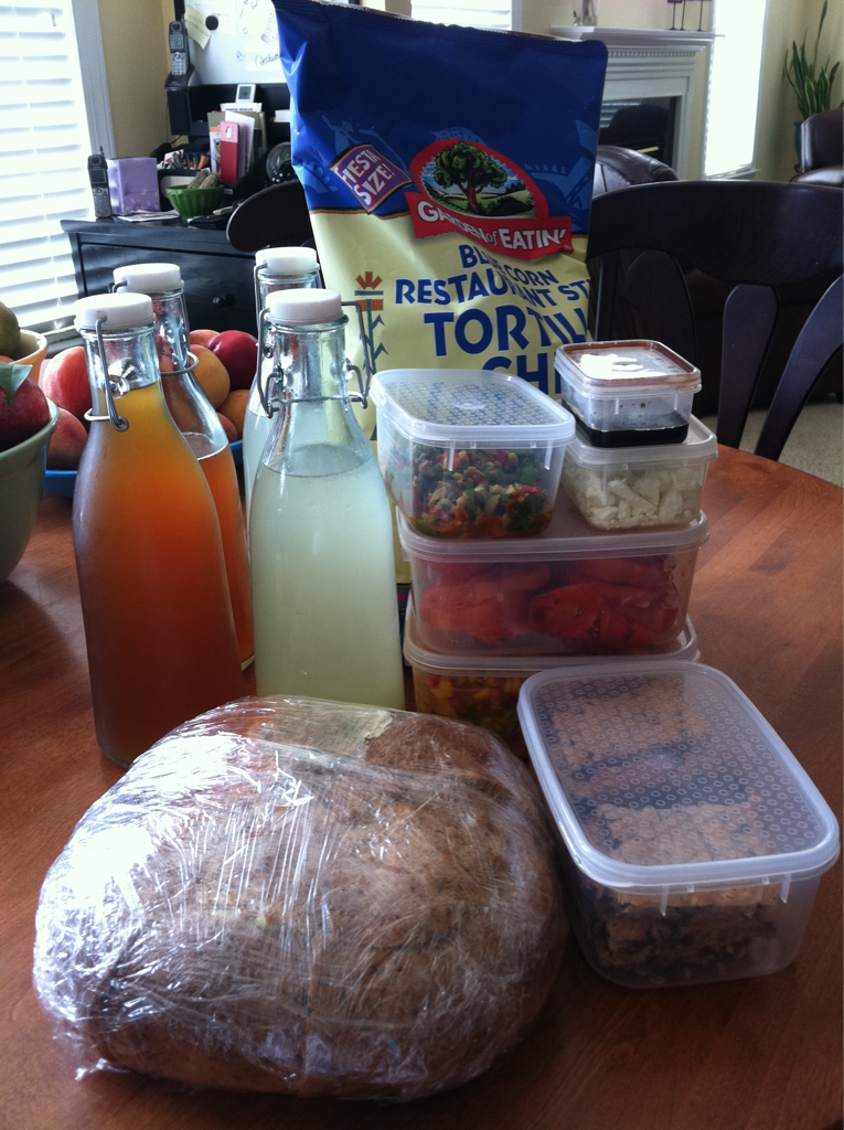 My wonderful friend Elizabeth and her kids are visiting us this afternoon. So a packed us a nice lunch that we can enjoy pool side. Here is a picture of what the lunch looks all packed up. I am going to transport it all to the pool in our rolling ice box. Stayed tuned for the next post where I will show you what exactly I packed for us to eat.