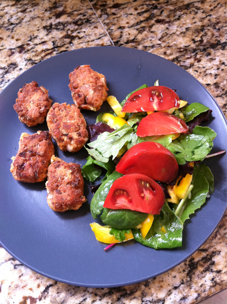 We are having a very lazy day. It's already lunch time but the kids and I are still in our PJs. For lunch I decided to be a little more productive. I made gluten free and egg free salmon cakes. Along with it I am serving a simple salad with homemade citrus dressing topped with heirloom tomatoes from the farmer's market. I know it looks like a time consuming lunch but it's not. This all took less then 20 minutes to put together and serve.