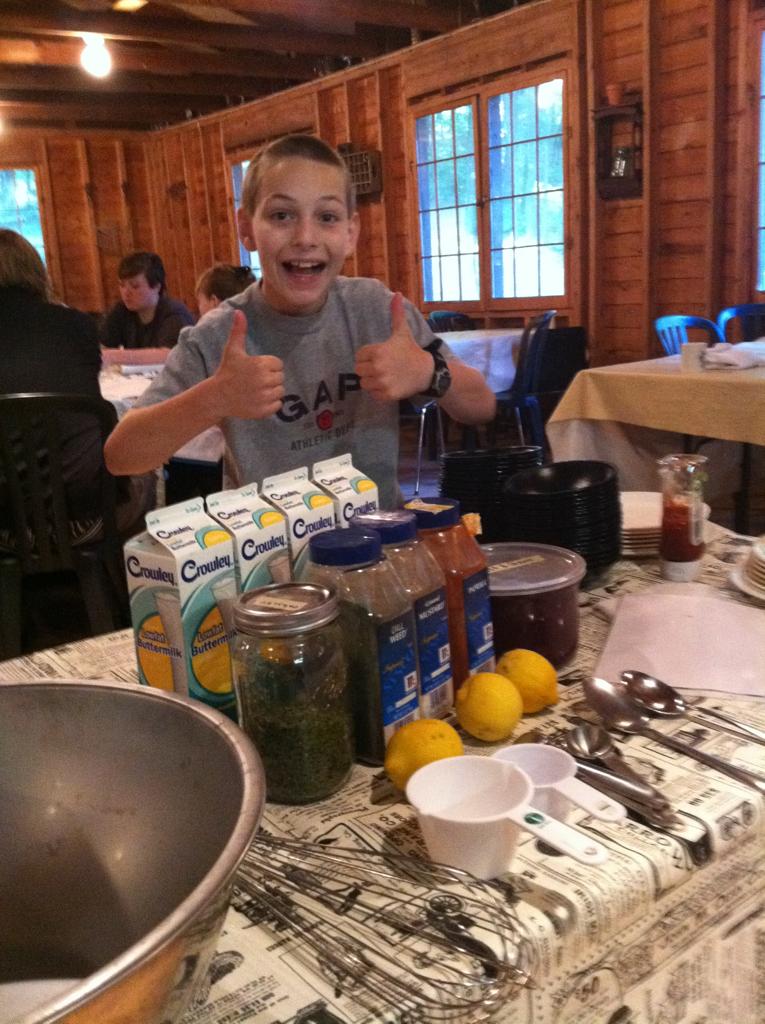 Camper Matthew Burger helping to make Buttermilk Ranch Dressing for the salad bar.