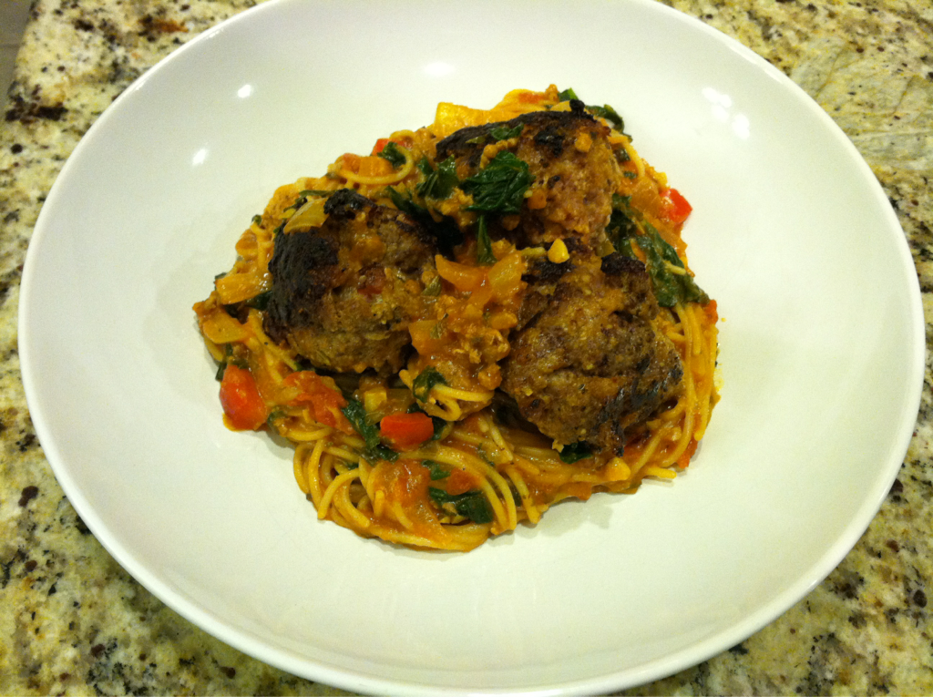 Gluten Free Spaghetti with Bacon Meatballs Today is super raining and dark outside, totally not my favorite weather. On a day like this it's nice to have some comfort food because it makes us all warm and fuzzy inside. Plus it give the sense that we are taken care of. This is something I desire to make my husband and kids feel. So tonight I am serving my take on yummy traditional spaghetti and meatballs. The sauce is a thick pasta sauce with tons of onions and kale with a touch of bacon, ground turkey, and ground beef. The giant meatballs are made with ground turkey, ground beef, touch of bacon, onion flakes, and garlic. I wish you could smell my kitchen right now.