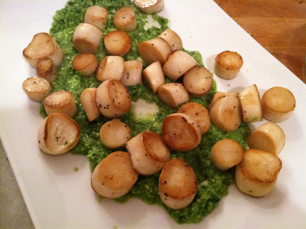 Water seared king oyster mushrooms on a bed of basil pesto. These are incredible and taste exactly like scallops!