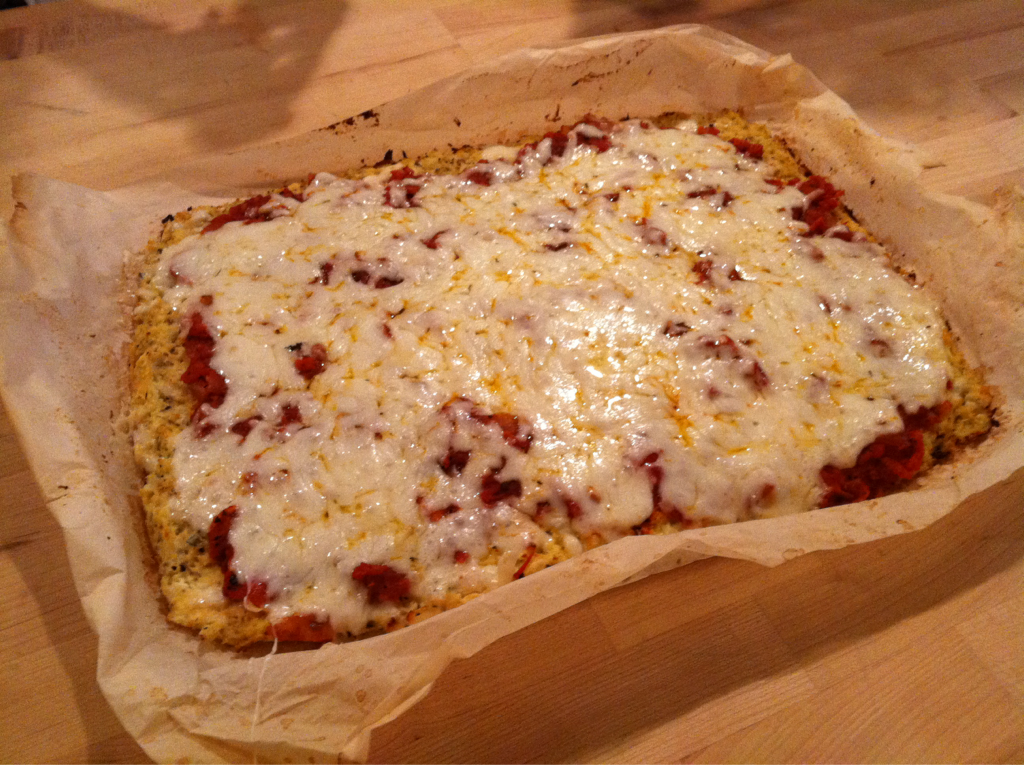 Pizza made with cauliflower crust and topped with goat cheese mozzarella.
