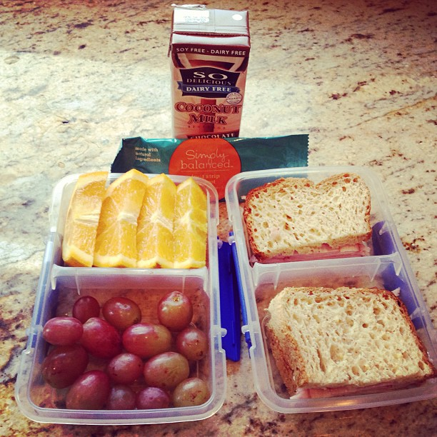 Simple and quick lunch. Fruit, ham sandwich on gf bread, fruit snack and chocolate coconut milk.