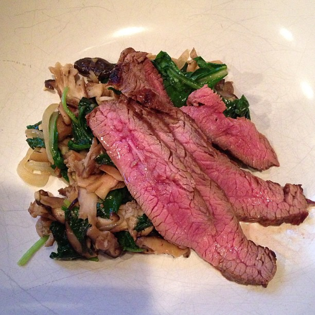 Yay Dinner! Buffalo Flank Steak over Garlic Sesame Mushroom Sauté.