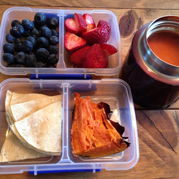 Kids Lunch Munch- tomato soup, cheese quesadilla for dipping in soup, baked sweet potato, blueberries and strawberries.