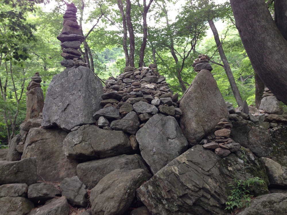 The top of Jirisan. Rewards are these rocks and a natural spring to help you hydrate before turning around and walking back down.