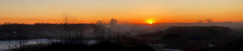 The sun rising over our asphalt plant at our Bridgeport location.
