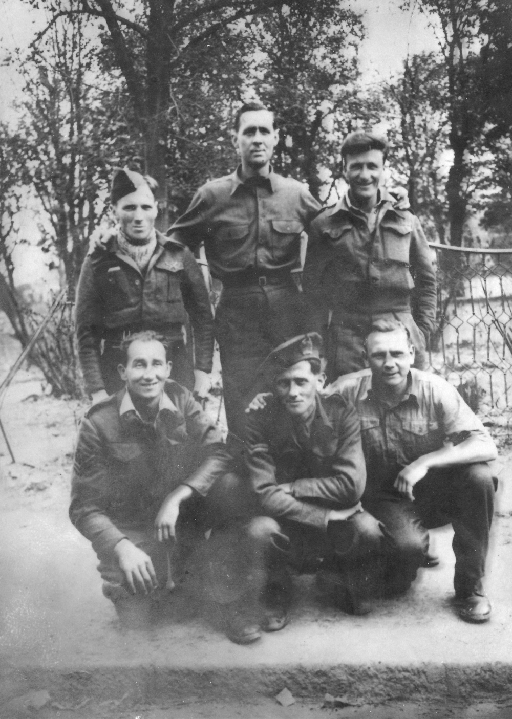 - Bruce Murray (back row, right hand side) at a POW Work Camp.