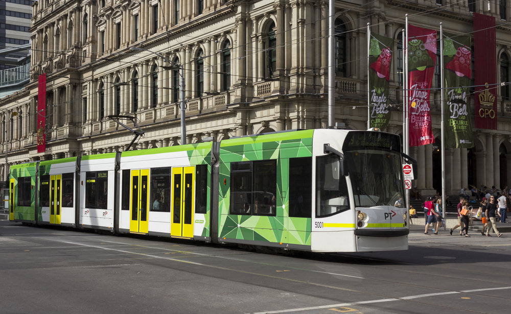 by tram - There are two tram stops outside the Melbourne Convention Centre and one stop at the Melbourne Exhibition Centre.No. 12, 96, 109 travel along Clarendon Street from South Melbourne, Port Melbourne and St Kilda and service the CBD via Collins and Bourke Streets.No. 70 runs along Flinders Street stopping on the north side of the Melbourne Convention Centre.The City Circle Tram service also provides a free and convenient way to get around central Melbourne. Tourists, shoppers, office workers and families can use the City Circle Tram to travel to major attractions, shops and city events.Download the TramTracker or PTV app on your smart phone or click here to plan your journey by Tram.